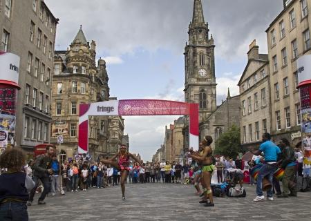 EDINBURGH, UK: AUGUST 2: Unidentified group of black dancers perform on the street at the Edinburgh Festival Fringe in Edinburgh, UK on August 2, 2012