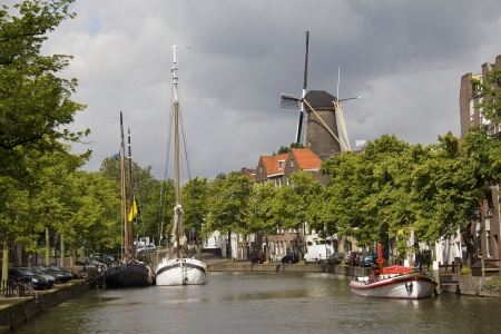 schiedam: Canal and Windmill in Schiedam, Holland