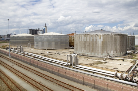 railway track: Railway tracks and oil silos in the Rotterdam industrial area Stock Photo