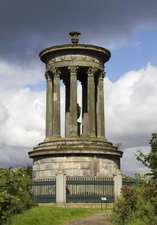 rainclouds: Monument on Calton Hill in Edinburgh, Scotland, UK Stock Photo