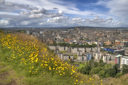 View over Edinburgh from the hill in Holyrood Park with spring flowers photo