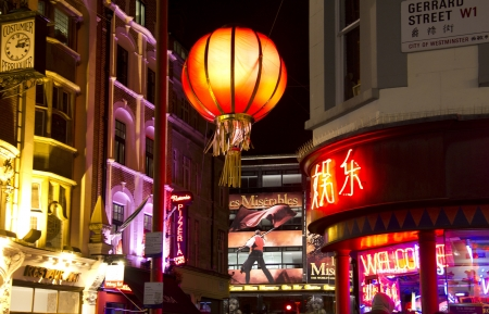 London, UK - December 30, 2013: Chinese lantern in Gerrard Street and poster of Les Miserables on a theater in China Town in London, UK on December 30, 2013 Stock Photo - 17765167