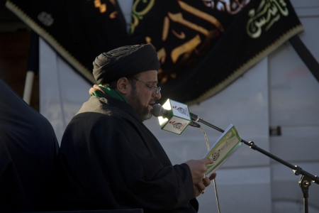 religious service: London, UK - January 1, 2013: Shiite Imam praying at a religious service organised by the Husseini Assocation at Marble Arch in London, UK on January 1, 2013 Editorial