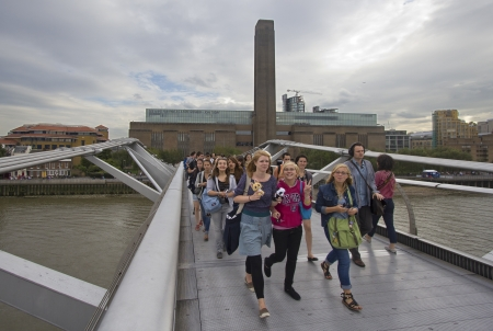 London, UK - July 25, 2011: School excursion and other pedestrians on Millennium Bridge in London on July 25, 2011 in London, UK