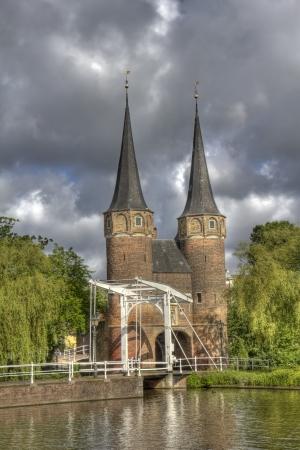 rainclouds: The Oostpoort gate under dark rainclouds in Delft, Holland