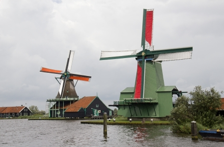 Historical wooden windmills at Zaanse Schans in Zaandam near Amsterdam, Holland photo