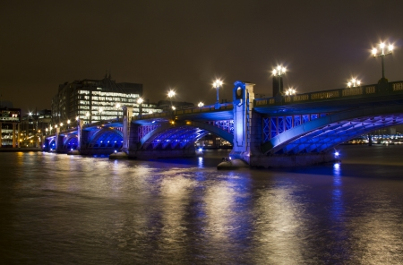 southwark: Colorfully illuminated Southwark Bridge across the Thames in London, UK