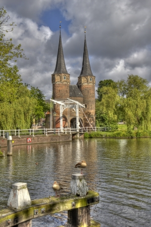 rainclouds: The Oostpoort gate under dark rainclouds in Delft, Holland