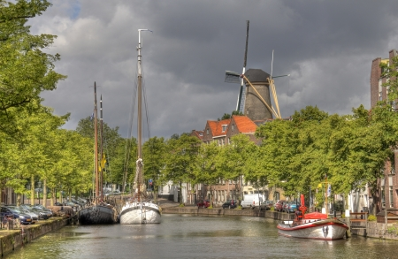 schiedam: Canal and Windmill in Schiedam, Holland