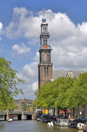 westerkerk: Amsterdam, Holland - July 19, 2013: Canal and tower of the Westerkerk church on July 19, 2013 in Amsterdam, Holland
