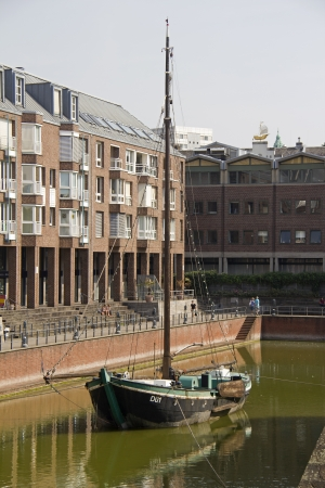house gables: Dusseldorf, Germany - August 22, 2013  Historical boat in the old harbor of Dusseldorf, Germany on  August 22, 2013  Editorial