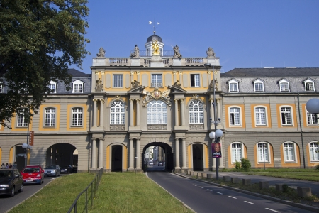 Bonn, Germany - August 30, 2013  Road with traffic of cars passes through the gate of the historical building of Bonn University in Bonn, Germany
