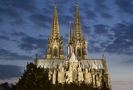dom: Cologne Cathedral in Germany illuminated against a late evening sky Stock Photo