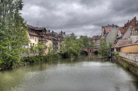 rainclouds: View of the Karlsbrucke across the Pegnitz river in Nuremberg, Germany