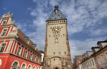 clocktower: Clocktower and red house in the historical center of the city of Speyer in Germany