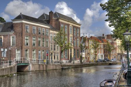 Historical houses on a canal in Leiden, Holland