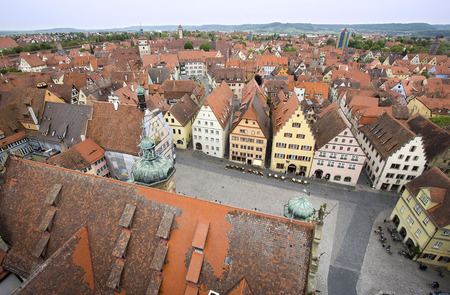 town square: View from the tower of the Rathaus city hall over the red tiled roofs of the historical houses and the town square of Rothenburg ob der Tauber, Germany Stock Photo