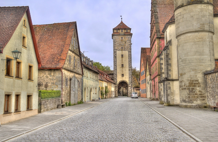 der: Historical houses and a city wall tower in the old city of Rothenburg ob der Tauber, Germany