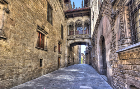 old quarter: Flamboyant style bridge between buildings in El Bisbe street in the Gothic Quarter in central Barcelona, Spain