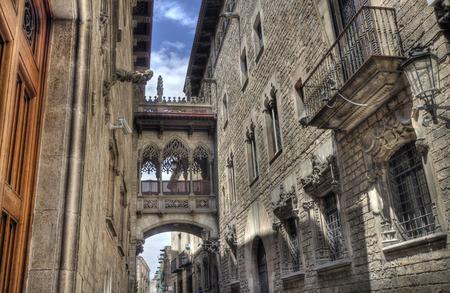 carrer: Del Bisbe street in the Barri Gotic historical area of Barcelona, Spain Stock Photo