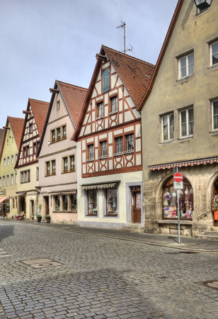 fachwerk: Street with historical buildings and shops in Rothenburg ob der Tauber in Germany