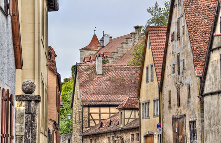 der: Historical houses with red tiled roofs in the old city of Rothenburg ob der Tauber, Germany