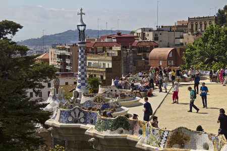 religious building: Barcelona, Spain - May 26, 2015: People walk on the balconey of the Guell park created by Gaudi, on May 26, 2015 in Barcelona, Spain Editorial