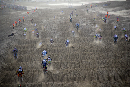 scheveningen: Scheveningen, Holland - November 28, 2015: People participating in the Red Bull Knock Out motocross race on the public beach at Scheveningen, Holland on November 28, 2015.