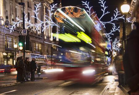 busses: London, UK - December 29, 2012: Double decker busses ride through Regent Street decorated for Christmas in London, UK on December 29, 2012