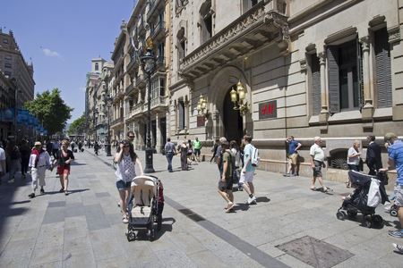 shopping buggy: Barcelona, Spain - May 27, 2015: People walk in shopping street in Barcelona, on May 27, 2015 in Barcelona, Spain Editorial