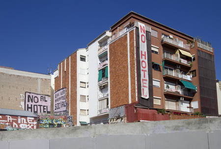 slogans: Barcelona, Spain - May 27, 2015: Slogans on apartment buildings against new hotels and tourism in Barcelona, on May 27, 2015 in Barcelona, Spain Editorial