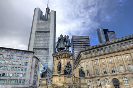 monument historical monument: Gutenberg monument on Grossmarkt square with historical buildings and modern office highrise in Frankfurt, Germany Stock Photo