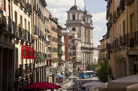 isidro: Spain,Madrid - May 27, 2016: People and traffic of cars and a public transport bus in the street below the San Isidro church in Madrid, Spain on May 27, 2016 Editorial
