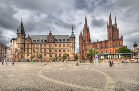 townhall: Wiesbaden, Germany - April 29, 2014: People walk on the Demsches Gelande square in front of the new townhall and the  Marktkirche church in Wiesbaden, Germany on April 29, 2014