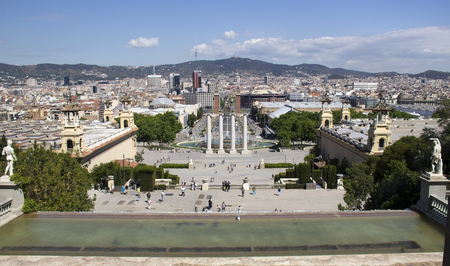 espanya: Barcelona, Spain - May 24, 2015: Tourists on the steps down to the magic fountain and Placa dEspanya in Barcelona, Spain on May 24, 2015.