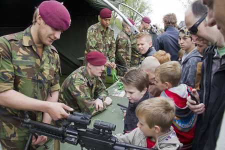 The Hague, Holland - May 9, 2015: Military people show weapons to people on a military event in The Hague, Holland on May 9, 2015