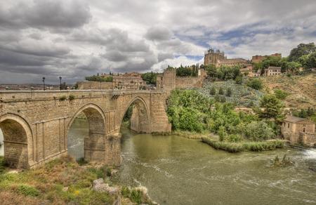 The historical Puente de San Martín, or Saint Martins brdge, across the river Tagus in Toledo, Spain