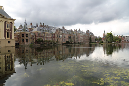 The Binnenhof parliament buildings across the Hofvijver pond in The Hague, Holland