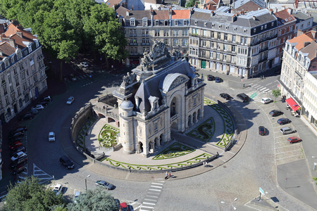 Triumphal arch Porte de Paris in Lille, France seen from the belfry tower of the city hall