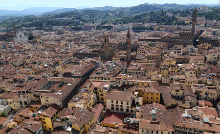 Cityscape of Florence, Italy, with the Palazzo Vecchio and other landmarks and the hills of Tuscany beyond
