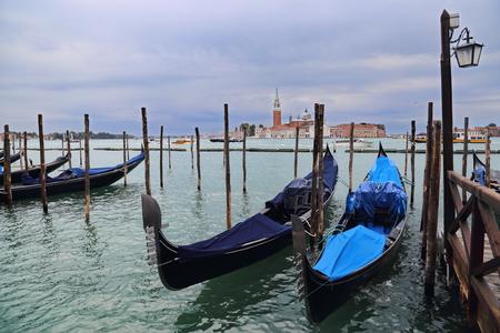 Gondolas and the church of San Giorgio Maggiore in Venice, Italy