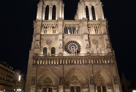 Notre Dame cathedral illuminated at night in Paris, France