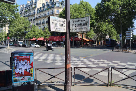 Paris, France - May 19, 2018: Street signs of Boulevard Sait Michel and Saint Germain in Paris, France on May 19, 2018