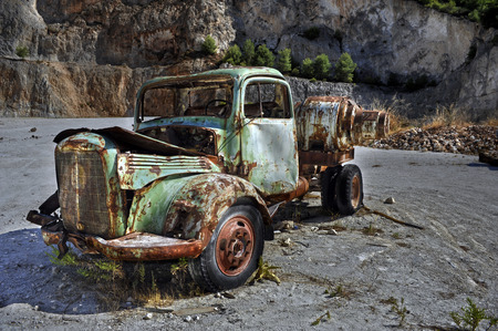 Rusty green vintage truck in a quarry. Stock Photo