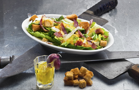 ides: Caesar salad - original version with egg dressing and crunchy bacon topping (Ides of March theme)