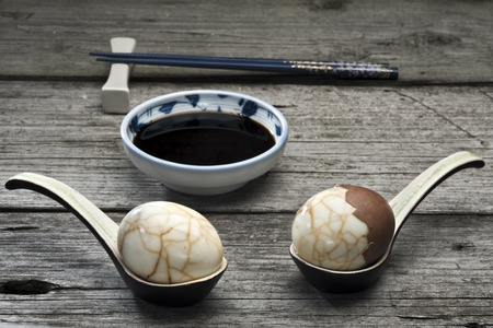 albumin: Two traditional Chinese tea eggs served on crackle glaze ceramic spoons . Perfect appetizer for Chinese dinner or for Asian fusion themed Easter picnic.