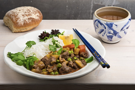 meaty: Bo Kho - traditional Vietnamese beef stew, a favorite meaty breakfast dish with lots of spices, mainly star anise, lemongrass, cumin, cilantro. Served with green tea and fresh white bread.