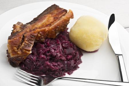 crackling: Pork belly roast with caraway seasoned crackling, red sauerkraut and German style potato dumpling