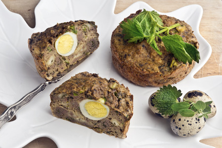 Spring pate (or meat pie stuffing) with pork liver, fresh nettles and marjoram and quail egg.