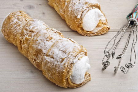 Cream horn – Austrian, Czech and German confection known Schaumrolle, Schillerlocken or Kremrole. Puff pastry roll filled with whipped and stiffened egg whites or cream and sprinkled with sugar.